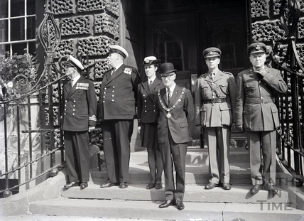 A group of dignitaries assemble for the camera outside the Guildhall. Date unknown.