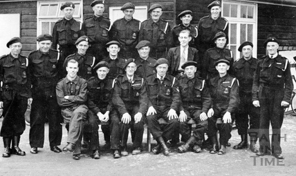 An indented group in military uniform c.1945