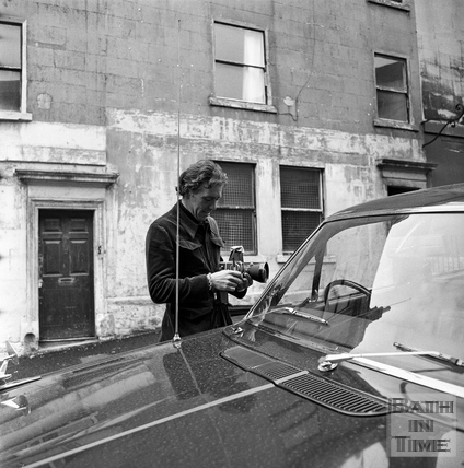 Lord Snowdon checks his camera in the Ballance Street area March 1972.