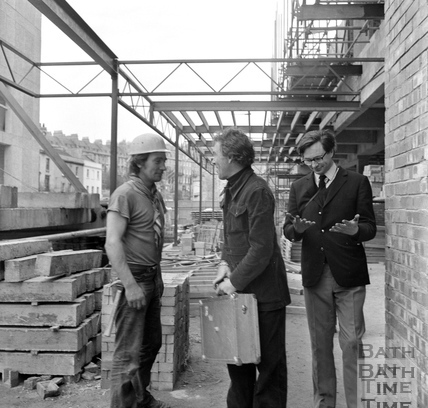 Lord Snowdon thanks a site worker as Adam Fergusson inspects his hands at the Beaufort (Hilton) Hotel site March 1972