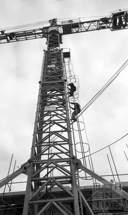 Lord Snowdon and Adam Fergusson climb up the tower crane at the site of the Beaufort (Hilton) Hotel March 1972
