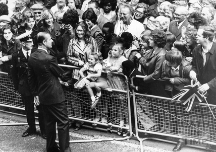 Prince Phillip talking to the crowd during a visit, August 1973