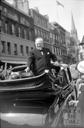 Winston Churchill in an open topped car outside the Guildhall 1950