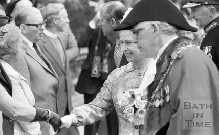 Mayor Raymond Charles Rosewarn guides the Queen down a line up during her visit to Bath August 1977