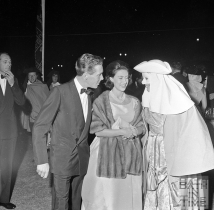 Princess Margaret and Lord Snowdon meet a performer in Parade Gardens, Bath Festival, June 1962