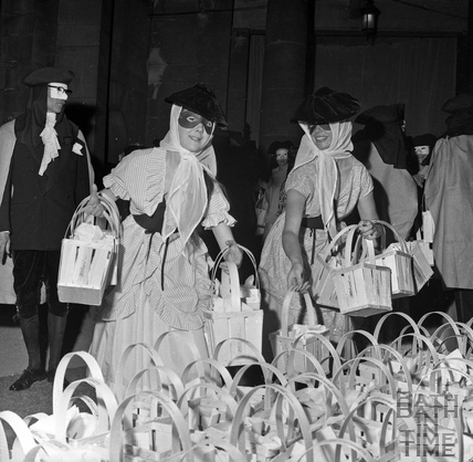 Goody bags are prepared for the visitors under Grand Parade June 1962