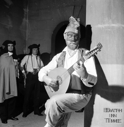 A troubadour provides background music for the guests at La Serenissima, June 1962