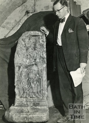 Michael Owen, curator of the Roman Baths with a piece of the Roman Altar c.1960s