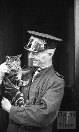 A rescue worker and cat, 1942