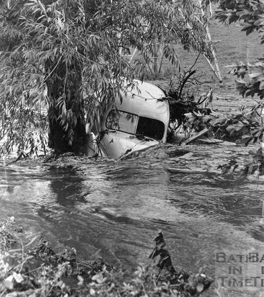 A swept away van against a tree in Keynsham, July 1968