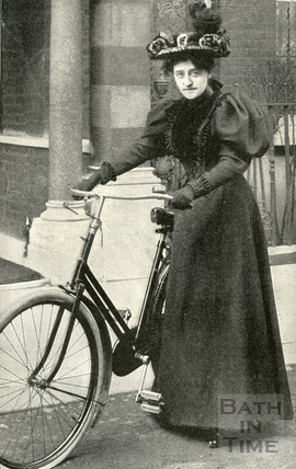 Madame Sarah Grand in Cycling Attire with bicycle, 1896