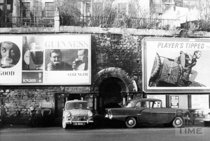 Advertisement hoardings on Walcot Street c.1960s