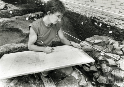 Marek Lewcun records the site during an archaeological dig at the Beau Street Baths 1989