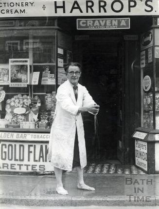 Mr Arthur Harrop mops up his shop in Weston Village, Oct 1968