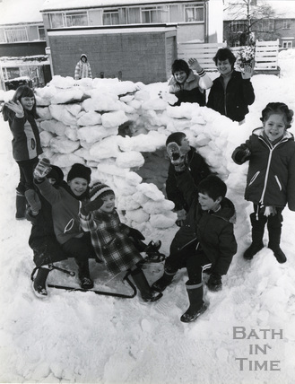 Children of Burford Close, Southdown playing in an igloo, January 1982
