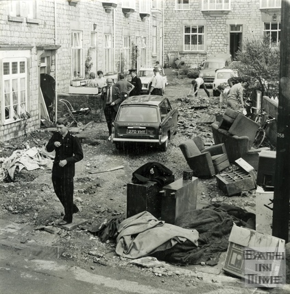 Clearing up after the floods at Montrose Cottages, Weston, 11 July 1968