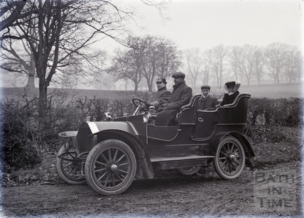 A family being driven in their motor car. c.1910s?