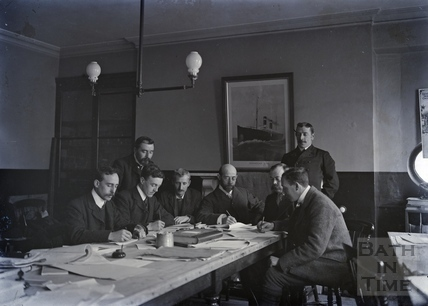 Men working at table c.1910s