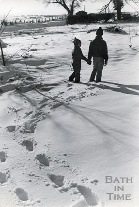 Two children walking in the snow, 18 Jan 1982