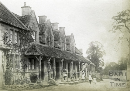 Children standing outside a row of cottages, Claverton c.1900