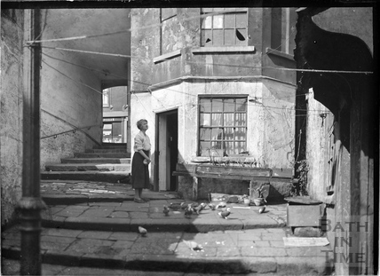 Feeding the pigeons, Parsons Yard, behind Walcot Street c.1930s