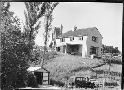Relatively modern house and church at Wellow c.1952
