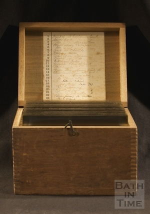 The original wooden storage box containing the plates for Box 152.