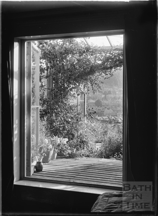 Looking through the window of No. 32 Sydney Buildings c.1920s