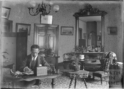 Self Portrait at his writing desk, inside dining room of 40 Great Pulteney Street c.1910