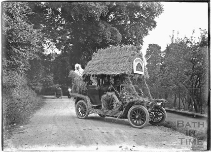 Car decorated with Monkton House Farmyard comes to Bath, Horseshoe Walk? c.1920s