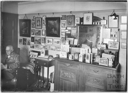 The Photographer's sideboard, self portrait and pictures on wall c.1950s