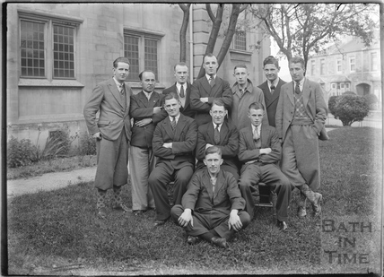 Group of young men in the Triangle in front of Oldfield Park Baptist Church, c.1930s