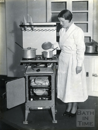 Lady and oven cooking, c.1930s