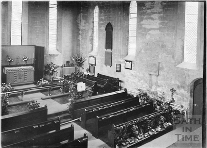 Interior of the chapel at St Martins Hospital, possibly decorated for harvest? c.1920s