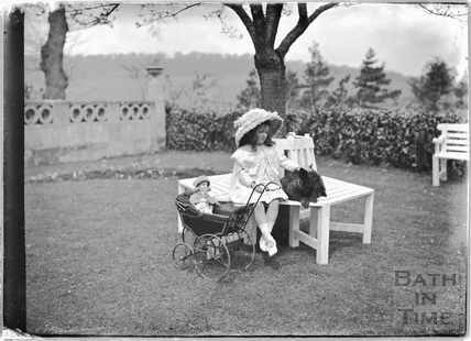 Young girl and toy pram,Monkton House, Warminster Road, Limpley Stoke c.1910s