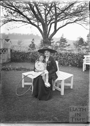 Mother, daughter and toy hoop in the gardens of Monkton House, Warminster Road, Limpley Stoke, c.1910s