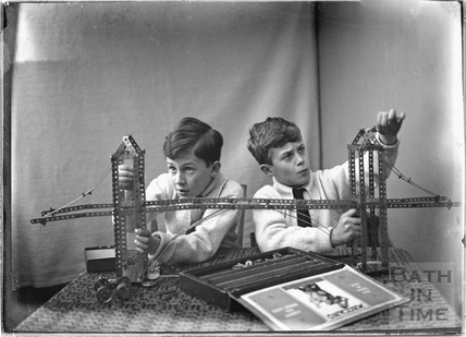The photographer's twin boys playing with their Mechano set. c.1923