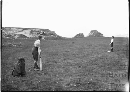 The photographer's twin boys playing cricket on Bathampton Down c.1919