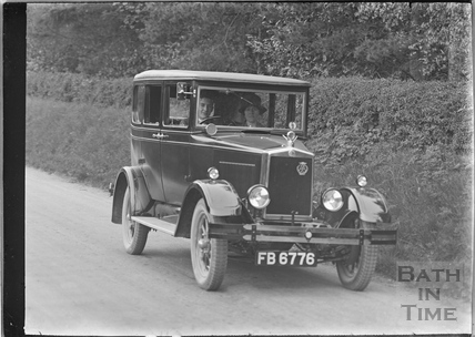 The photographer's wife and son in his car c.1929