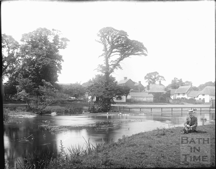 View across unidentified village pond c.1905