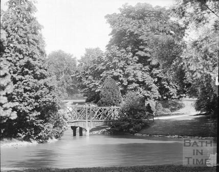 Rustic bridge and ornamental lake in Royal Victoria Park c.1905