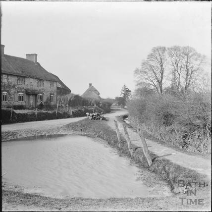 Unidentified village scene with pond c.1890s