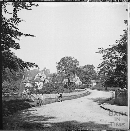 Cyclist and tricycle in Corston village c.1890s