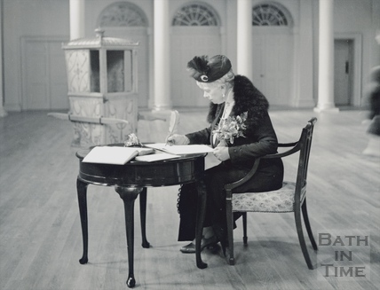 Queen Mary signing the visitors book at the Assembly Rooms c.1917