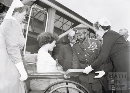 Emperor Haile Selassie smiles happily as Jeanette Reid hands him a present for the Empress October 1954