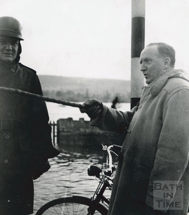 Bath MP Ted Leather at flooded Fiveways, Batheaston, 1960