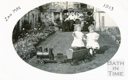 The photographers twins playing with their toy train in the garden of 32 Sydney Gardens, 2nd May 1913