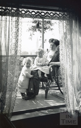 On the balcony of 32 Sydney Gardens, the photographer's wife Violet and twin boys, Sept 22 1912