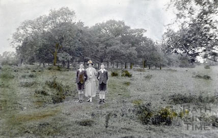 A crudely tinted photograph of the photographer's wife Violet and twin boys on Bathampton Down c.1923