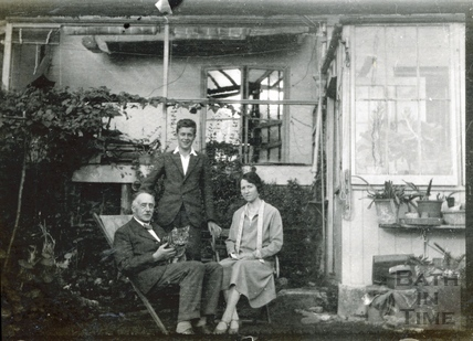 The photographer, his wife Violet and son Rupert in their back garden c.1929